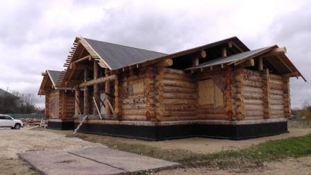 House of chopped cedar logs ISTRA