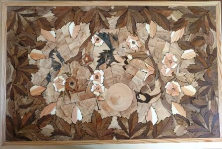 """The wooden table """"Birds"""" is made of wood cuts using the technique of Florentine mosaic"""
